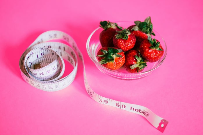 pink background strawberry bowl tape measure