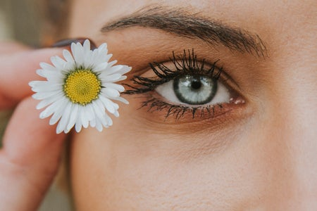 eye with a flower beside it
