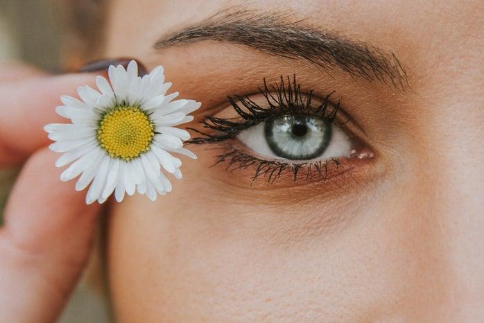 eye with a flower beside it