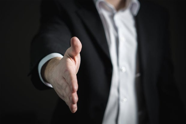 man with hand extended to shake hand