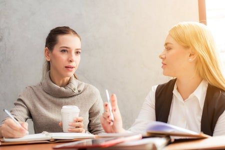 business women working together with coffee