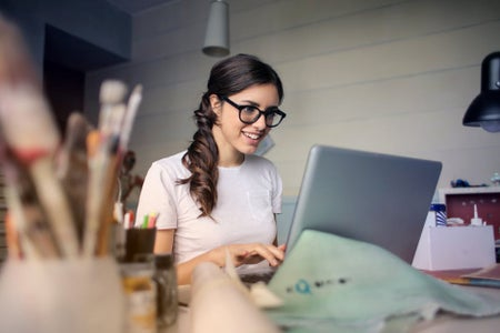 Photo of woman using her laptop