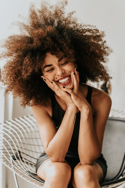 woman sitting and smiling excitement
