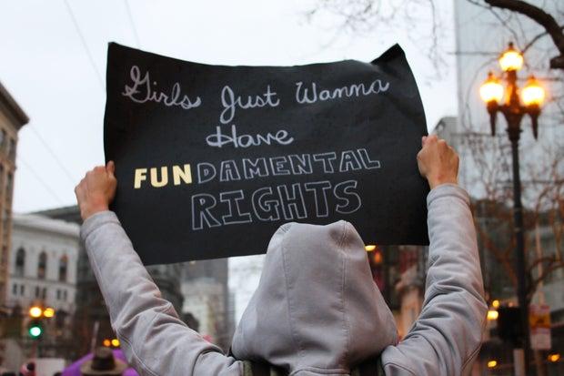 Feminist activist holding sign