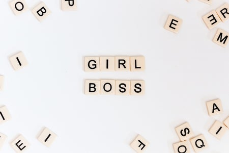 "Letter tiles spelling ""girl boss"""