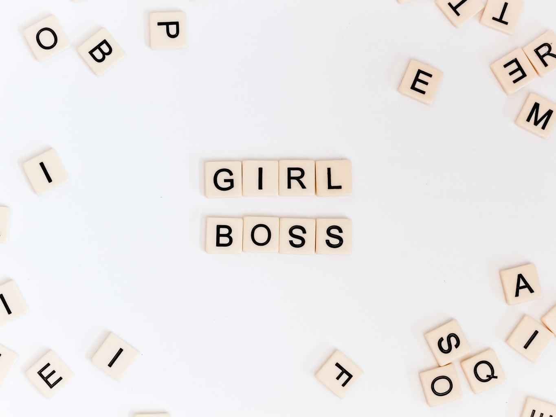 """Letter tiles spelling """"girl boss"""""""