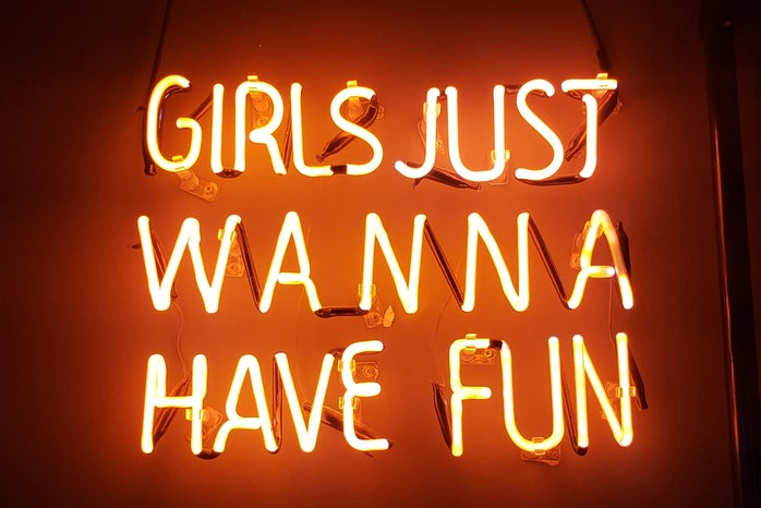 """Neon lights that spell out """"Girls Just Wanna Have Fun."""""""