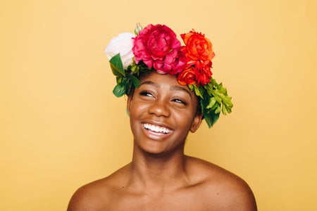 Smiling woman wearing flower crown