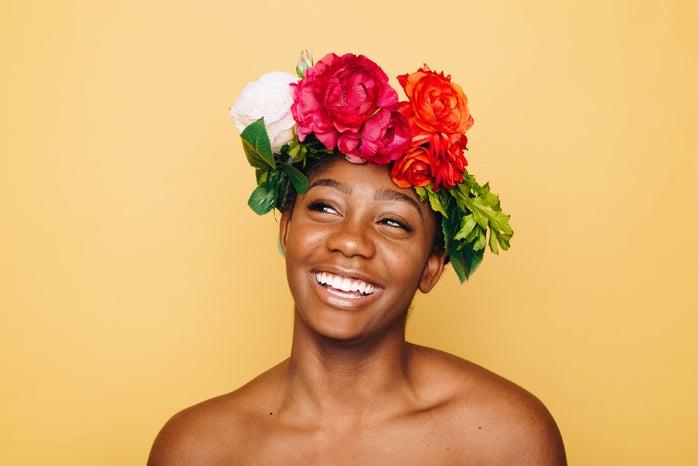 Smiling woman wearing flower crown