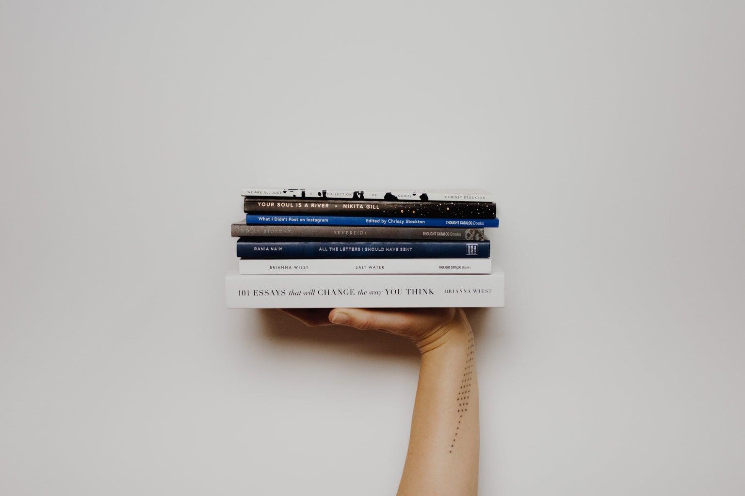 Female arm holding books