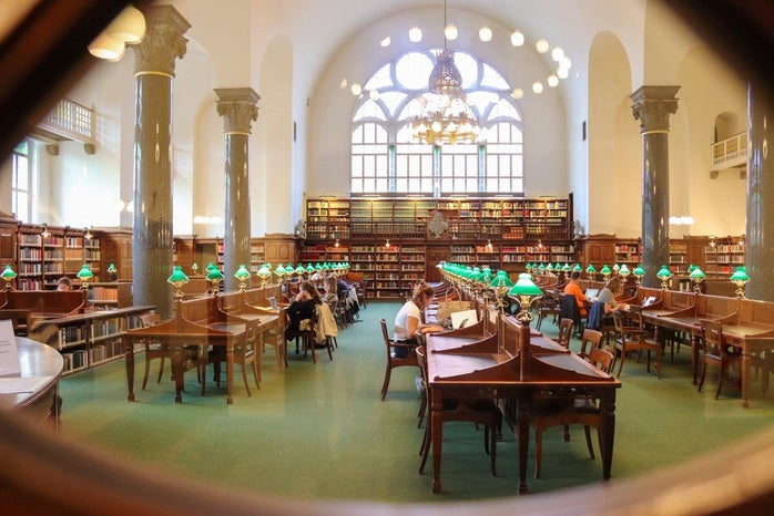 people studying in campus library