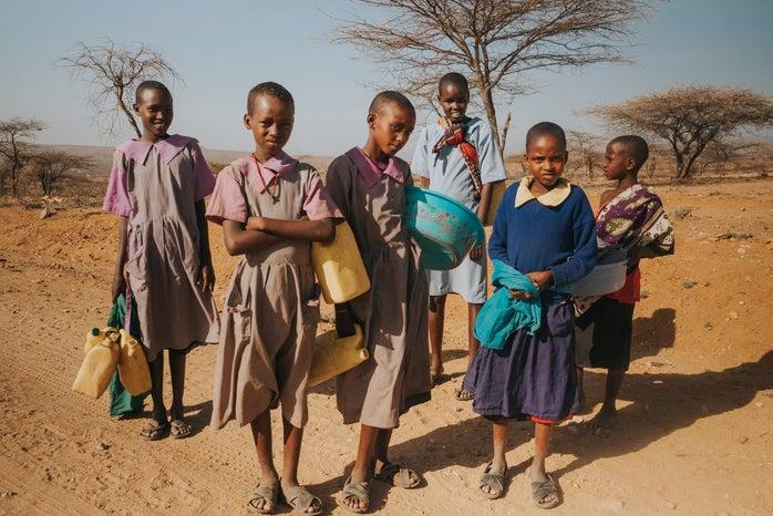 six children standing on desert