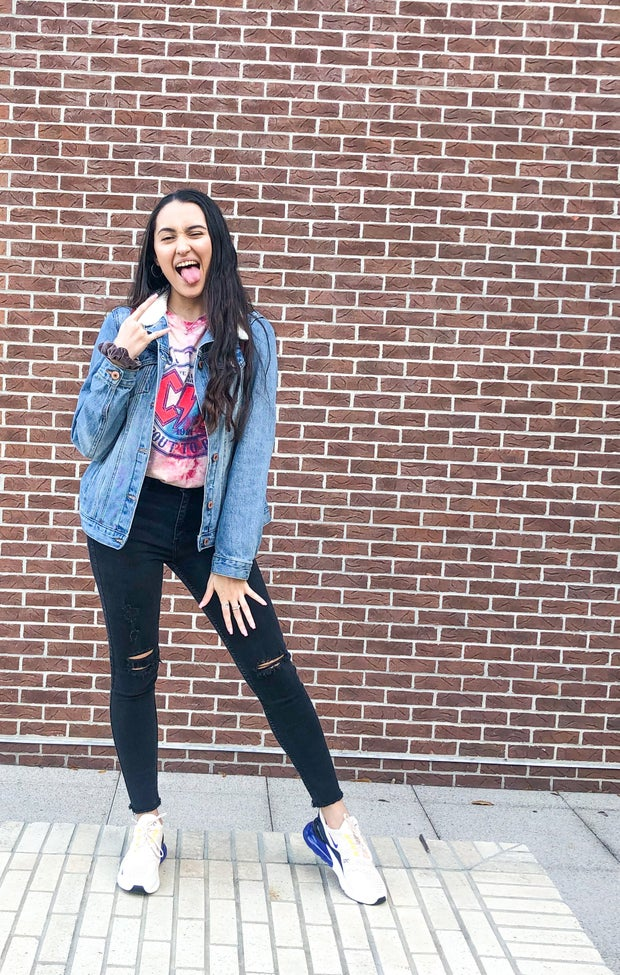 Me in an outfit against a brick wall
