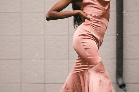 Woman wearing pink satin dress