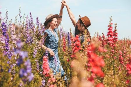 two girls in a field of flowers