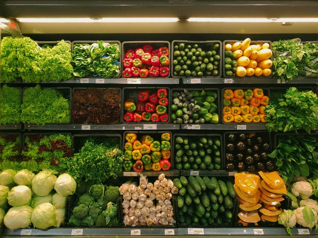a grocery store produce wall
