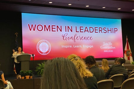 Women In Leadership on a big screen