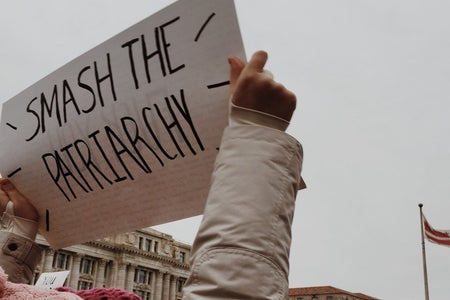 Woman holding sign