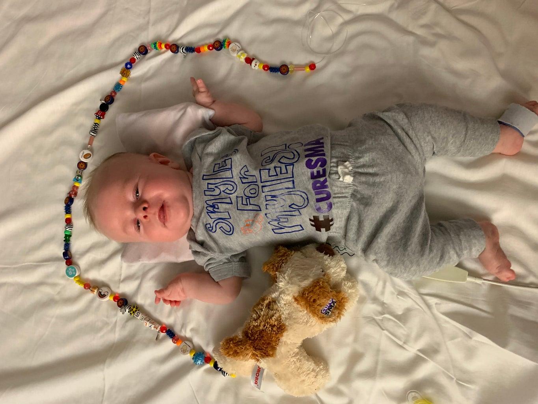 baby with stuffed animal #cureSMA