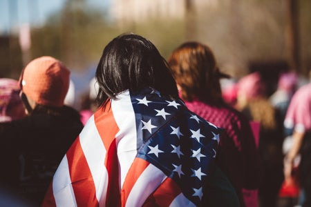 Girl with flag over her shoulders