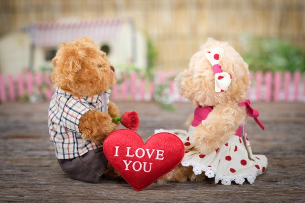 """two teddy bears with a heart that says """"i love you"""" between them"""
