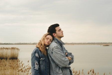 Couple wearing denim jackets