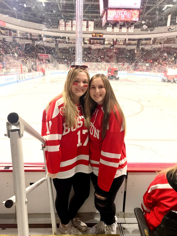 friends at a Boston University hockey game