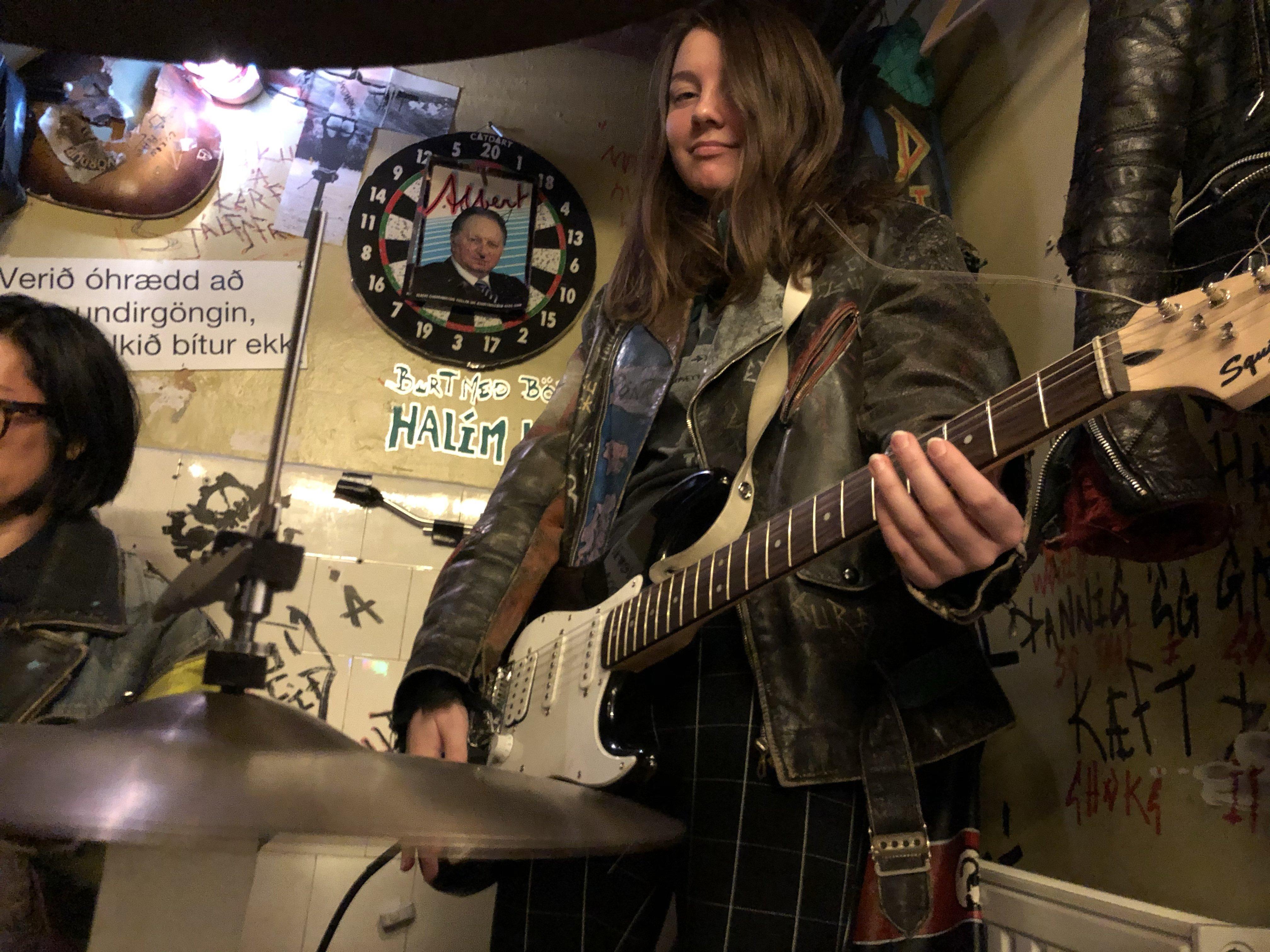 Myself at Icelandic Punk Museum with guitar