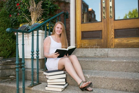 girl posing with books