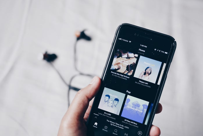 Phone and headphones with Spotify open