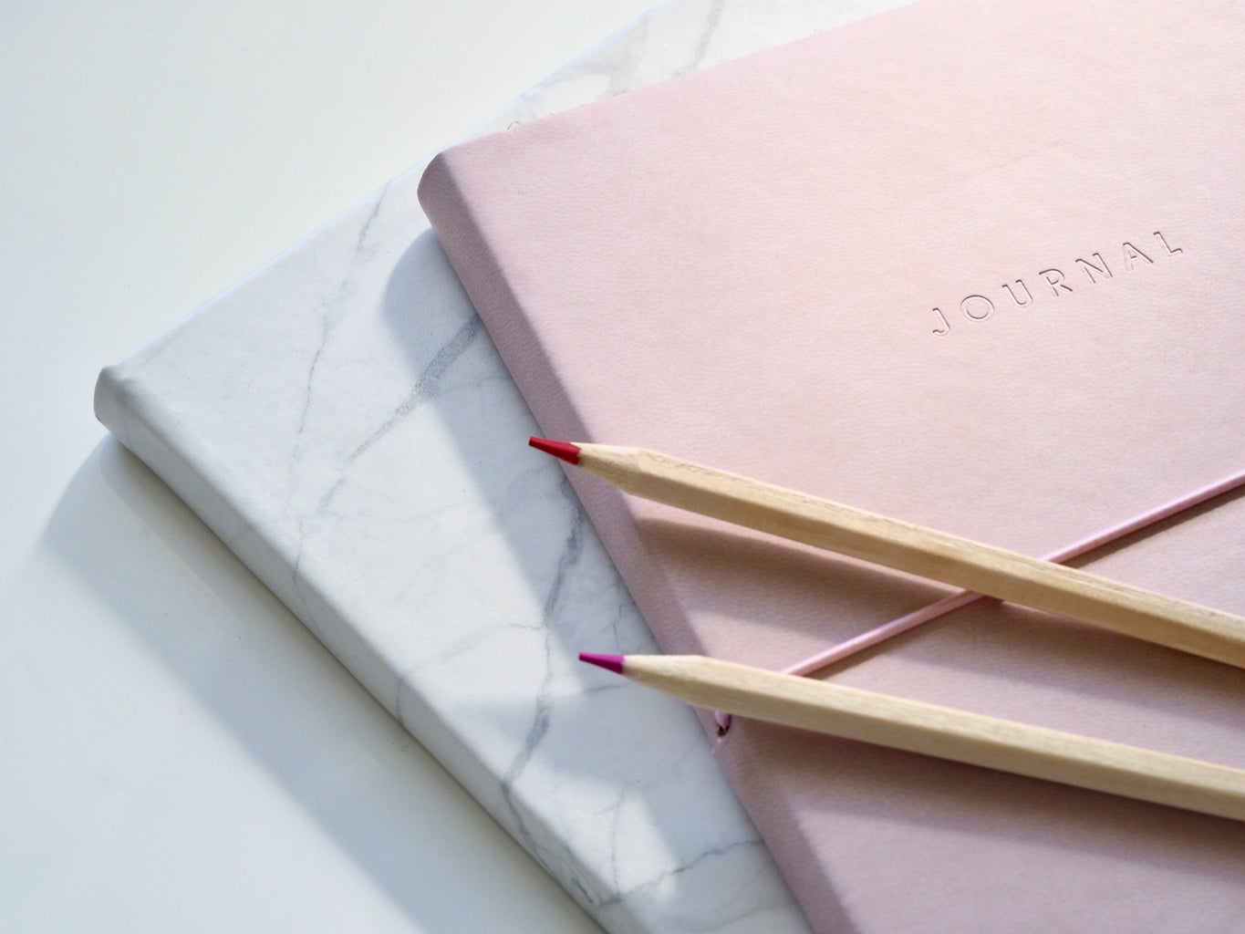 marble and pink notebook