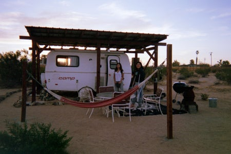 2 girls in front of RV trailer
