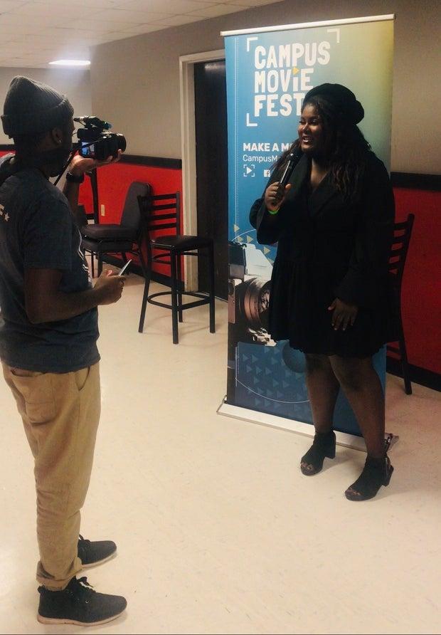 black woman celebrating her movie success