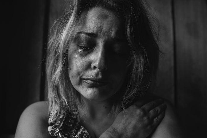 woman crying in b&w photo