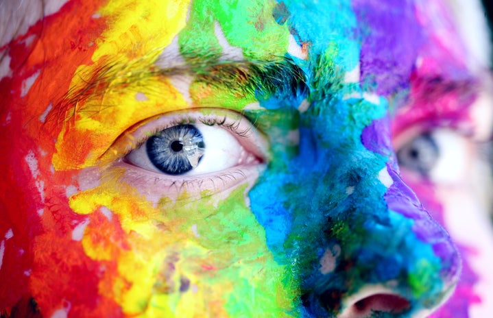 a face with colorful paint all over it