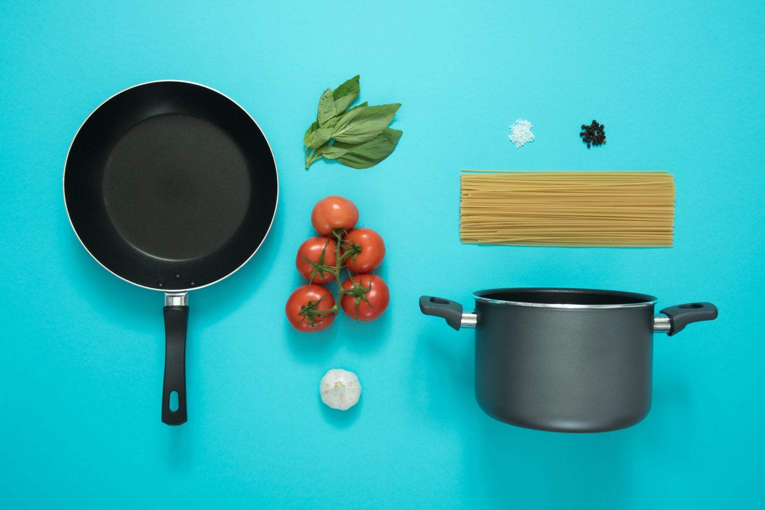 aesthetic layout of cooking supplies on a blue background