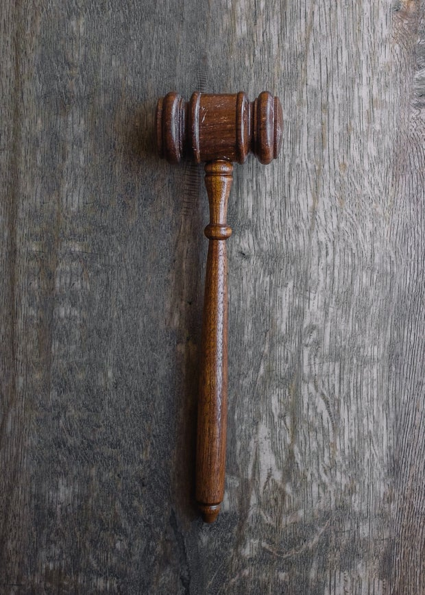 gavel sitting on a wooden table