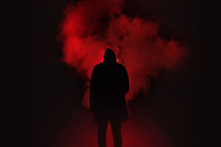 man standing in front of smoke