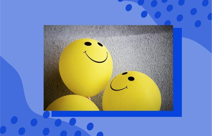 smiley face balloons on carpet