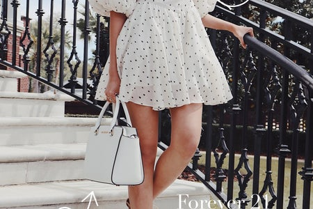 Girl in polka dot dress with outfit details