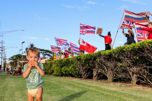 protest image of Mauna Kea with a baby