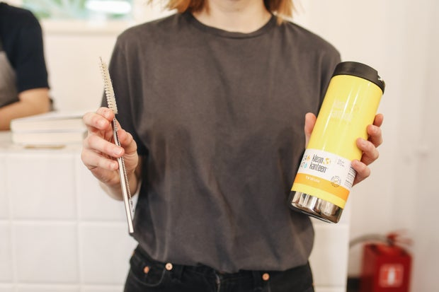 Woman holding thermos