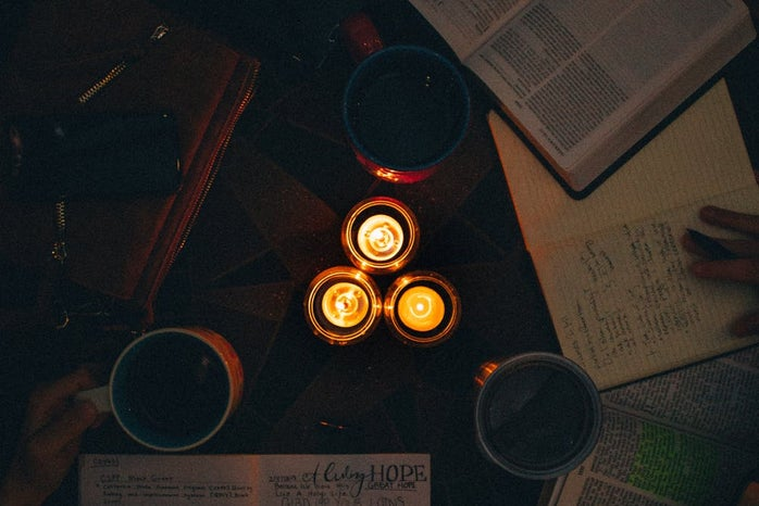dark study with candles taken from above