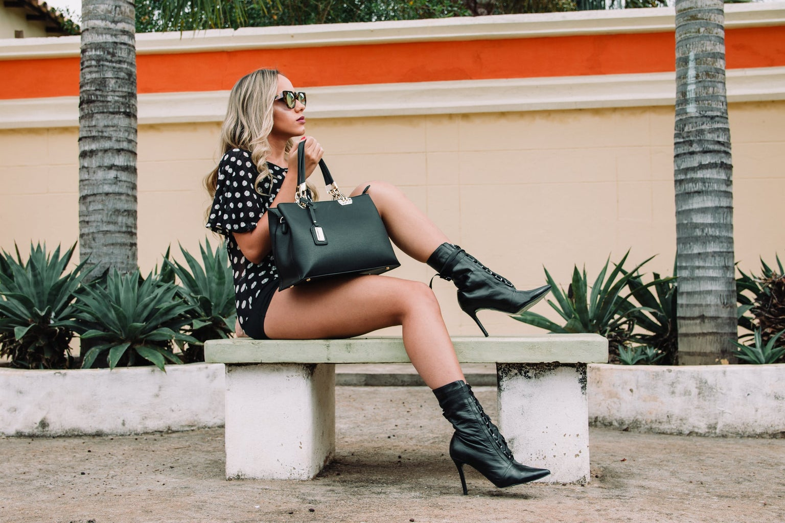 Girl on bench showing outfit