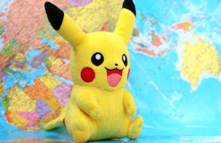 Pikachu (Pokemon) stuffed animal with world map background