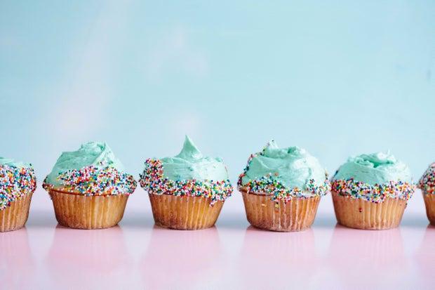 row of blue cupcakes