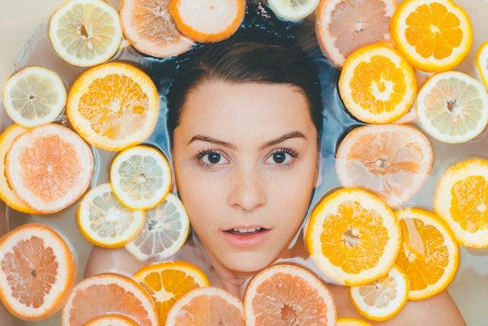 women surrounded by sliced lemons
