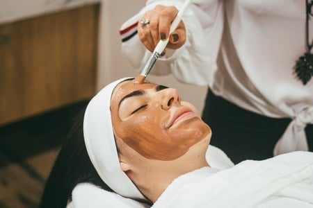 """a person getting a facial"""
