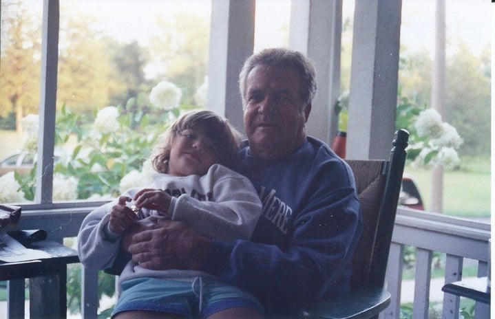 child sitting on porch with man