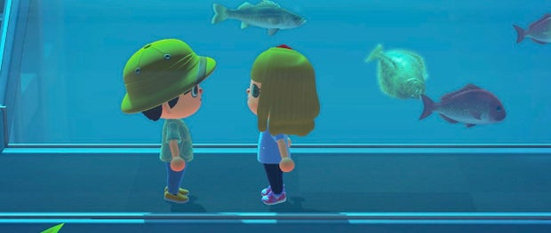 two animal crossing characters standing in an aquarium